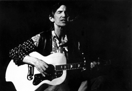 Townes Van Zandt playing guitar and singing.